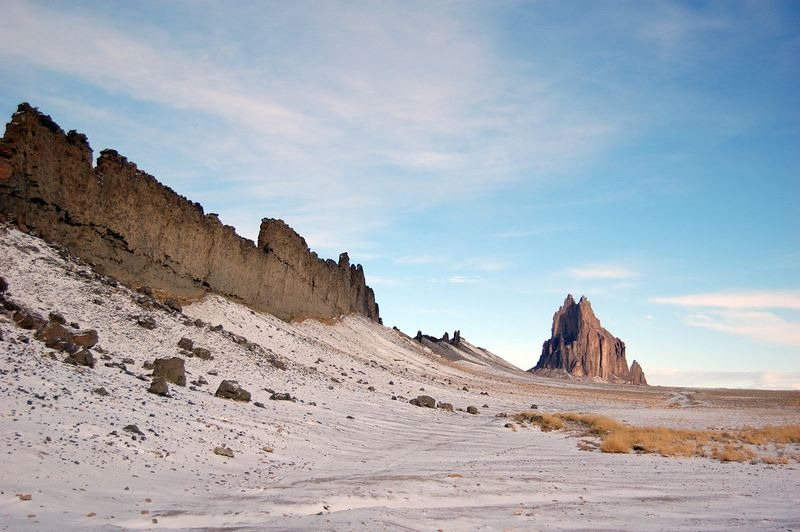 Shiprock New Mexico is composed of fractured volcanic breccia and black dikes of igneous rock called Minette.