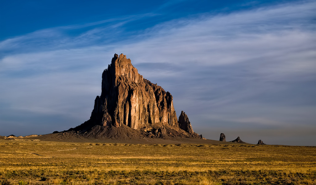 "Shiprock New Mexico ""The Winged Rock"" is a monadnock rising 1,583 feet above the high-desert plain of the Navajo Nation in New Mexico"