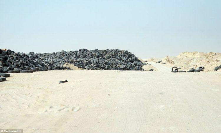 Every year gigantic holes are dug out in the sandy area of Sulaibiya filled with old tyres in the ground.