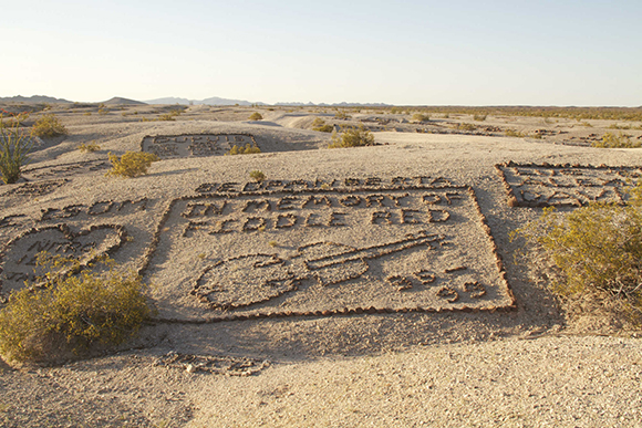 """During World War II, soldiers training in the desert north of Yuma, Arizona, started decorating a site they called """"Graffiti Mesa,"""" using rocks to write out their names in the white sand."""