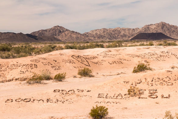 They expressed their feelings by placing stones on a piece of deserted land. They hoped that, even if they may never return home, their loved ones would get to see their message.