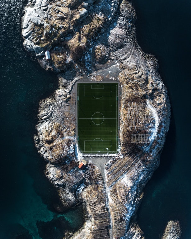 Henningsvær Stadium can hardly be called a football stadium; it has got no stands just a couple of meters of asphalt poured around the field and is used only for amateur football.