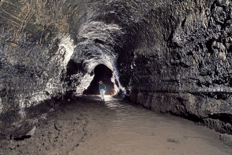 The cave can range in height from 30 feet and no light sources inside.