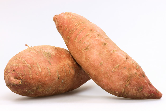 Sweet potatoes are tubers that grow under the ground just as white potatoes do, but there the resemblance ends.