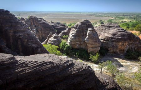 The amazing weathered rocks in the village of Fabedougou, near Banfora, in south-western Burkina Faso Domes have an entirely different origin.