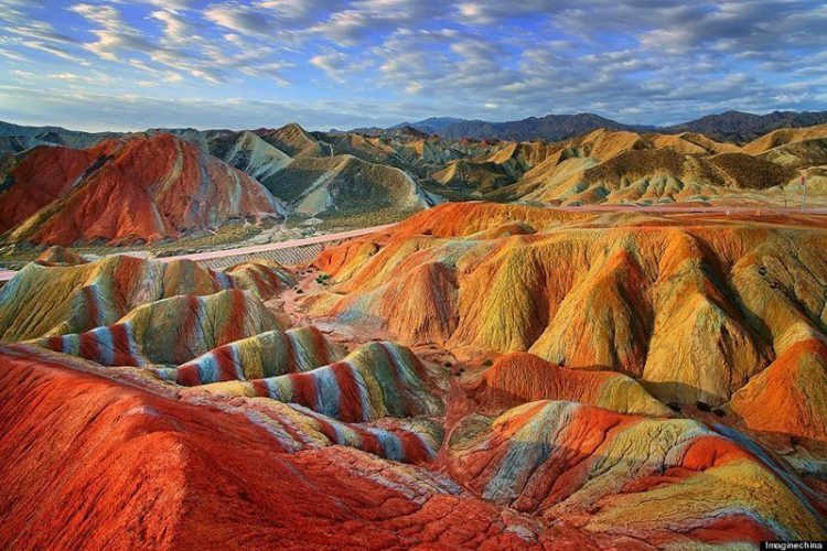 The naturally formed landscape is alive with shades of green, orange, blue, emerald, red and yellow. Source: Huffington Post-2