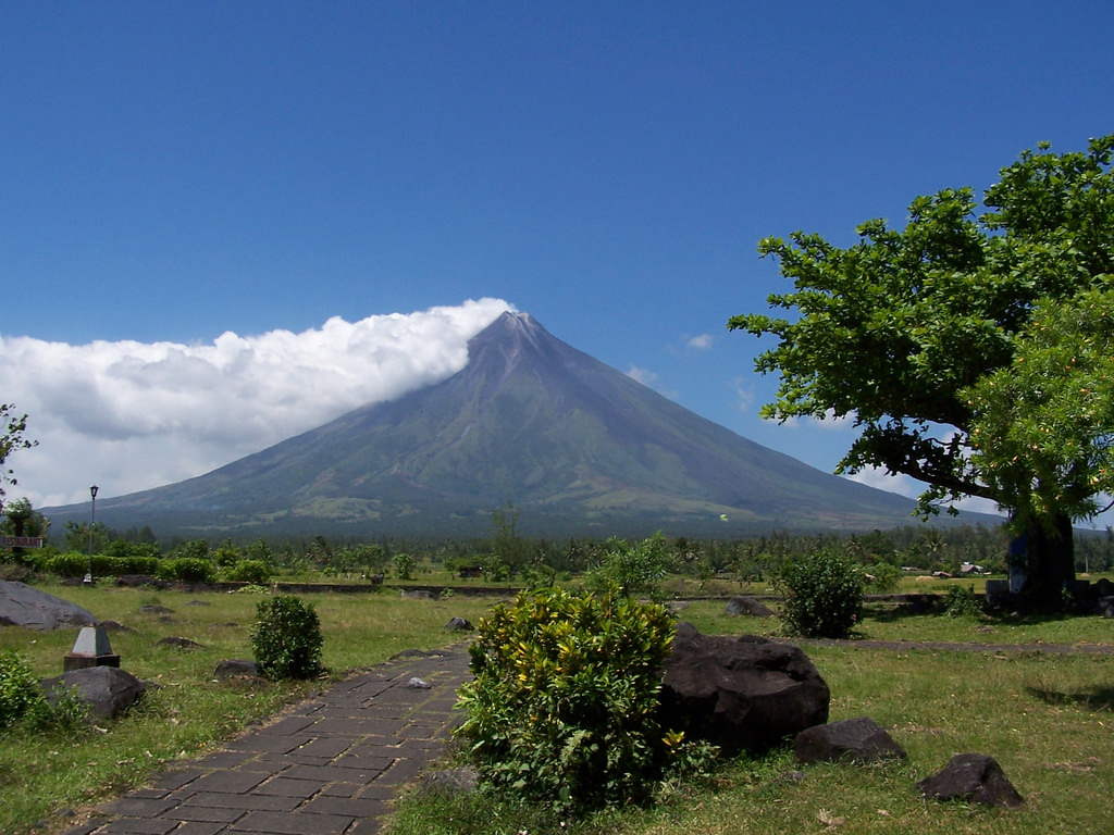 Mount Mayon, also known as the Mayon Volcano, is an active stratovolcano with a small central summit crater on the island of Luzon in the island of Luzon in Philippines.