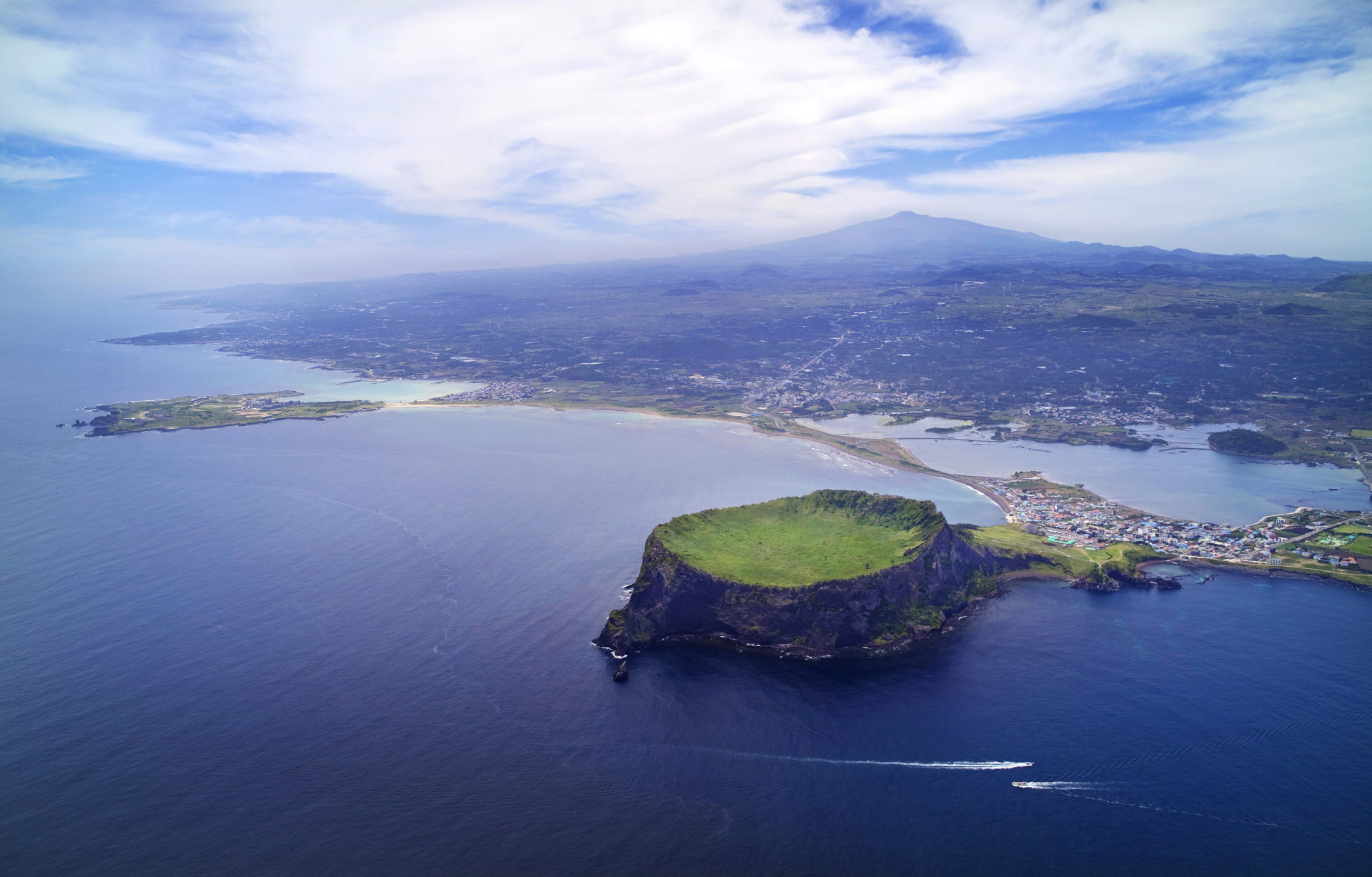 A central feature of Jeju is Hallasan, the tallest mountain in South Korea and a dormant volcano, which rises 1,950 m above sea level.