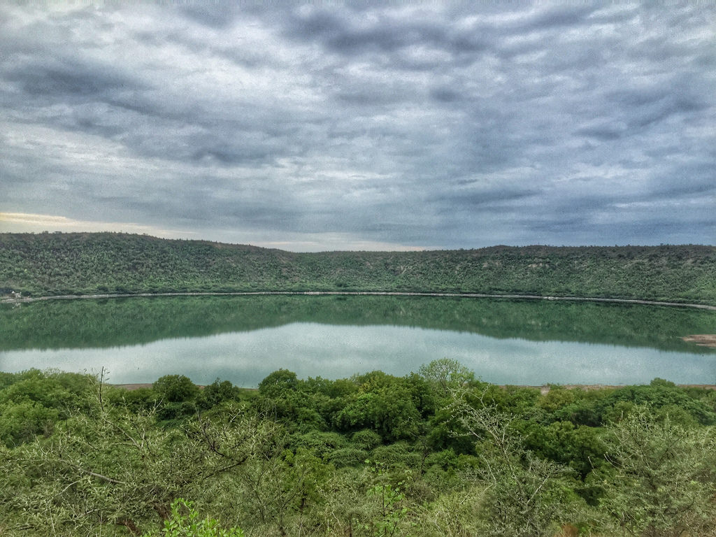 Lonar Crater has a mean diameter of 3,900 ft and is about 449 ft below the crater rim, and meteor crater rim is about 1.8 KM in diameter.