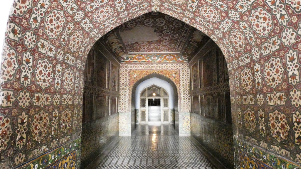 The walls of the tomb are inlaid with red sandstone and carved marble motifs.