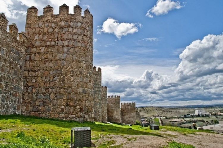 This wall is up to 10 feet thick and 40 feet high, and topped by a continuous battlement rampart-walk and parapet with merlons and cernels.