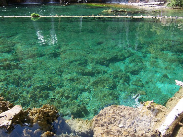 The bottom of lake is fully visible through crystal clear waters. This majestic lake is unearthed by a gold hunting prospector.