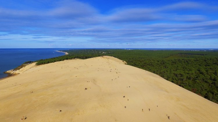 The sand dune is huge about 500 meter in width, 3 km in length and rising to a height of 107 meter above sea level.