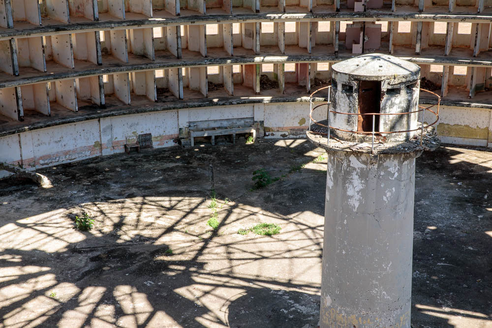 The elevated watchtower in one of the prison buildings. Photo Credit - Atlas Obscura
