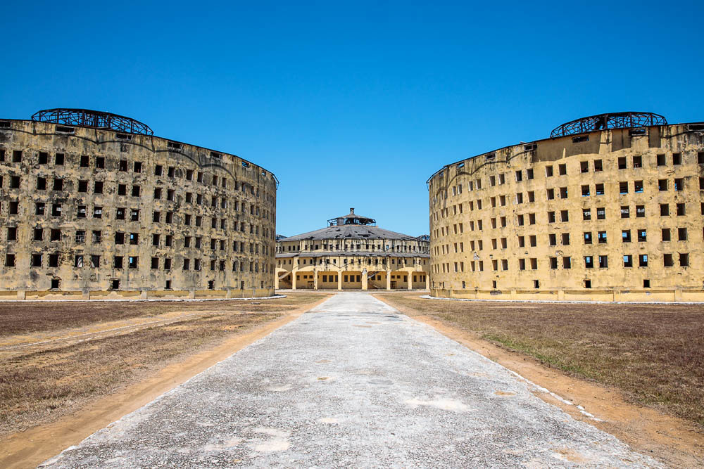 Three of the five panopticon buildings that make up the prison portion of Presidio Modelo. Photo Credit - Atlas Obscura