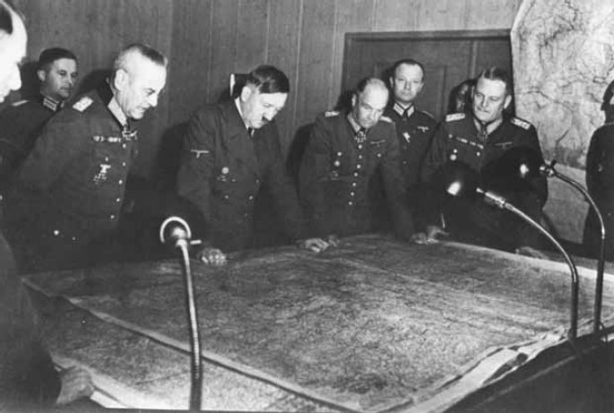 Hitler and his generals ponder wartime strategy.