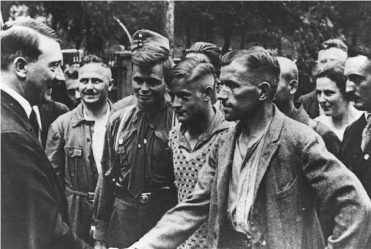 Hitler meets with German workers.