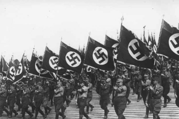 Storm Troopers advancing with Nazi colors.