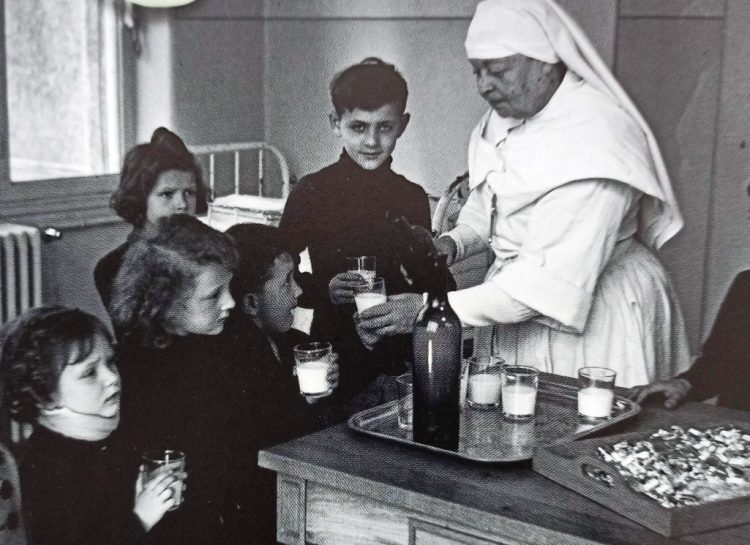 A nurse distributing vitamin supplements to children in a hospital in the south of France in 1941.