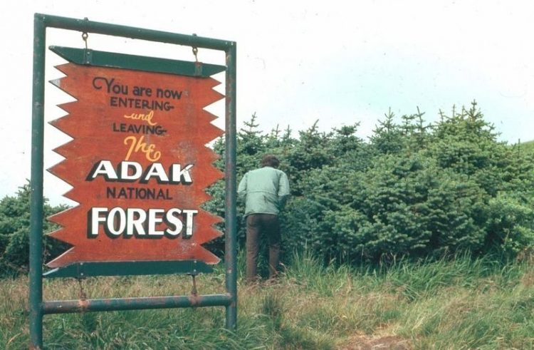 """At that time a signboard was placed. """"You are nowENTERING and LEAVING The ADAK NATIONAL FOREST"""" was placed here on a whim by soldiers in the early 1960s."""